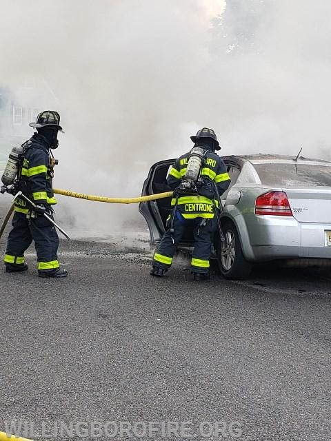 Firefighter Centrone works on extinguishing the fire in the passenger area.